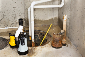 Photo of the process of replacing a basement sump pump